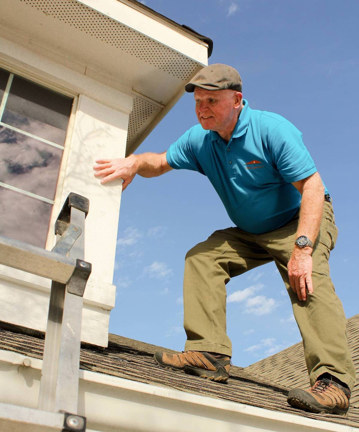 Home Inspector Rocky Cleveland on roof